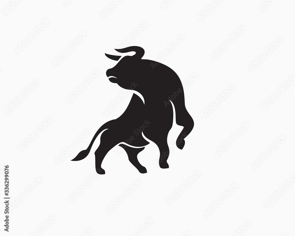 Fototapeta Strong bull attack look back logo design inspiration
