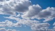 Beautiful timelapse of clear blue sky with moving fluffy sunny clouds along it.