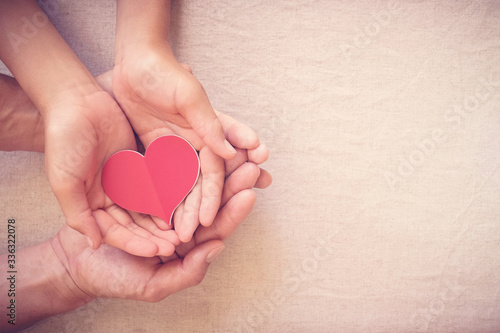 Fototapeta hands holding red heart, heart health, donation, happy volunteer charity, CSR social responsibility,world heart day, world health day,world mental health day,foster home, wellbeing, hope concept obraz