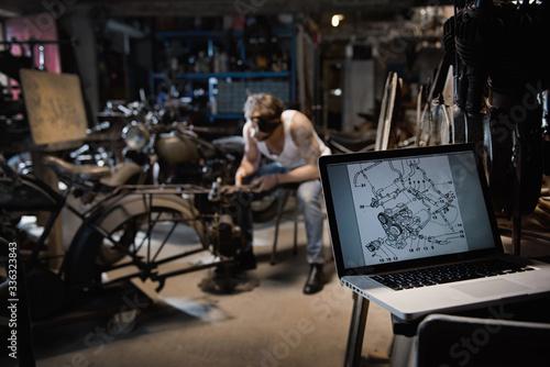 Cuadros en Lienzo Closeup on a laptop with a motor blueprint