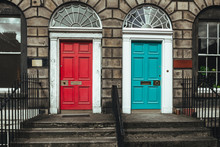Red And Turquoise Doors On A F...