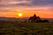 Sunset Over The South Downs National Park At Idsworth With The Ioslated  St Hubert's Church, Hampshire, UK