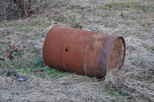 Rusted Drum On The Ground