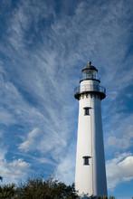 A White Brick Lighthouse Risin...