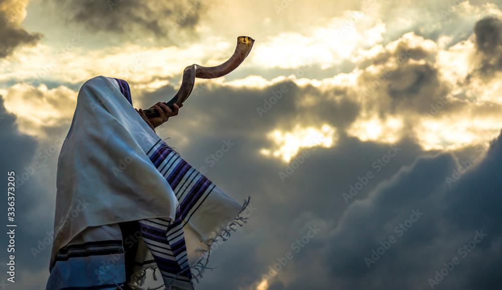 Fototapeta Jewish man in a tallith prayer shawl against dramatic sky