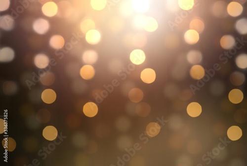 Fototapeta Garland lights golden pattern on brown blur background. Bokeh transparent pattern. obraz na płótnie