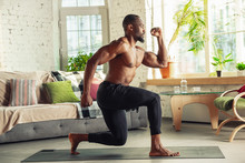 African-american Man Teaching At Home Online Courses Of Fitness, Aerobic, Sporty Lifestyle While Being Quarantine. Getting Active While Isolated, Wellness, Movement Concept. Training, Sit-ups.