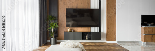Obraz Living room with tv, panorama - fototapety do salonu