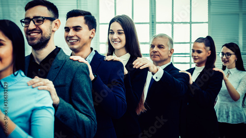 Fototapeta group of corporate employees standing behind each other.