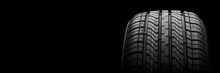 A  Black Isolation Rubber Tire, On The Black Backgrounds