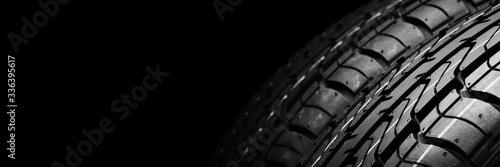 Fototapeta a  black isolation rubber tire, on the black backgrounds