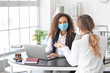 canvas print picture - Female lawyer in protective mask working with client in office
