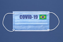 Medical Mask And Text Or Inscription Covid-19. Coronavirus Pandemic Concept. Brazil Flag.