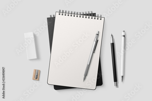 Fototapeta Real photo, spiral bound notepad mockup template with black paper cover, isolated on light grey background