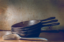 Cast Iron Skillets Stacked Wit...