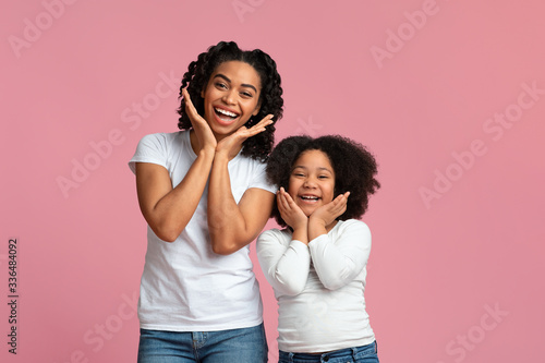 Fotografie, Tablou Cheerful black mom and daughter having fun together, making funny poses