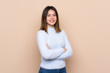Young Woman Over Isolated Background With Arms Crossed And Looking Forward