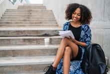 Afro-american Women Writing In Notebook.