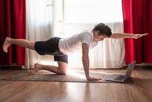 Man Practices Yoga Asana Chakr...