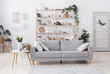 Leinwanddruck Bild - Stylish living room interior with modern light couch and home plants
