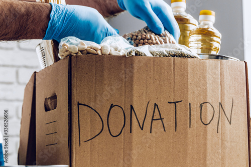 Fotografia, Obraz Donation box of food for people suffering from coronavirus pandemia consequences