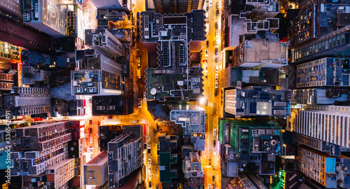 Aerial top view of downtown district  buildings in night city light Fotobehang