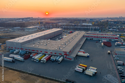 Cuadros en Lienzo Aerial view of the logistics park with warehouse, loading hub and many semi truc