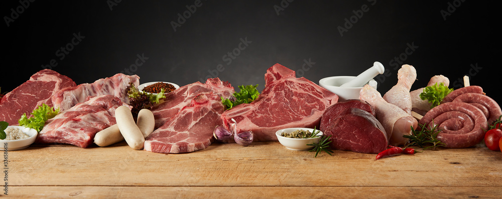 Fototapeta Display of assorted raw meats for barbecuing