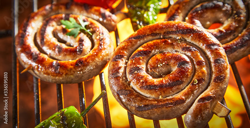 Coils of barbecued sausage on a hot fire Fototapete