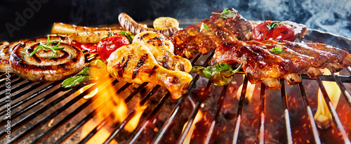 Fototapeta Panorama banner of assorted meat grilling on a BBQ obraz