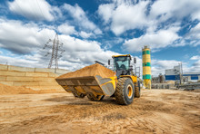 A Wheel Loader Carries A Full ...