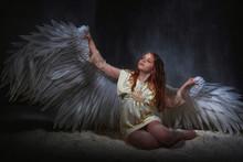 White Angel On A Dark Backgrou...