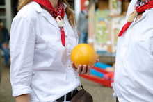 Woman Talking With A Man And Holding One Edam Cheese, During The Weekly Cheese Festival, Edam, The Netherlands