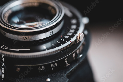 Macro and shallow depth of field image (selective focus) with the markings on the lens of a very old bellows photo camera (exposure time and f-stops) Canvas Print