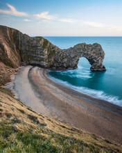 Durdle Door Rocks On Beach Coa...