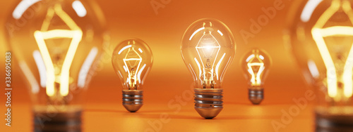 Fotografia bulb on orange background. 3D rendering.