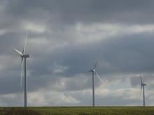 Row Of Three Wind Turbines In ...
