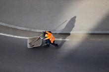 Worker Carries A Wheelbarrow W...