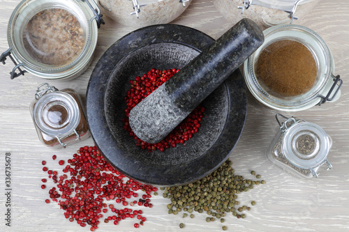 Wallpaper Mural pepper corns and mortar and pestle from top