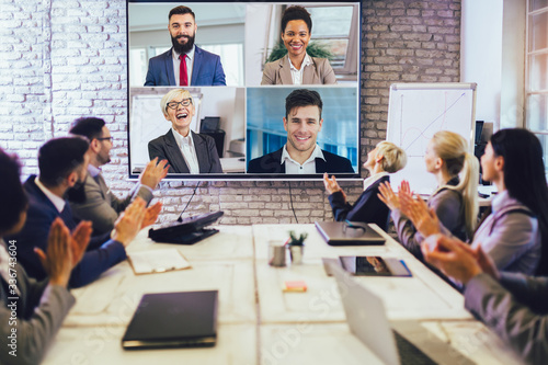 Business people looking at a screen during a video conference in the conference Fototapete