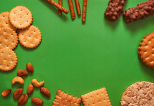 Composition Biscuits And Almonds On A Green Background Lay Flat