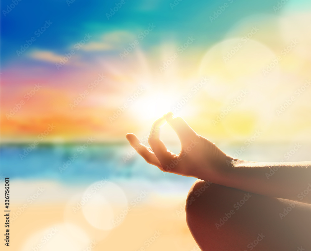 Fototapeta Yoga, meditation and healthy lifestyle. Sunset on the beach.