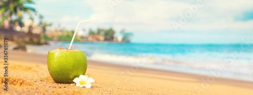 Fotografia Coconut on a beach cocktail. Selective focus.