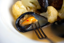 Close Up Of Spicy Mussels With Cauliflower