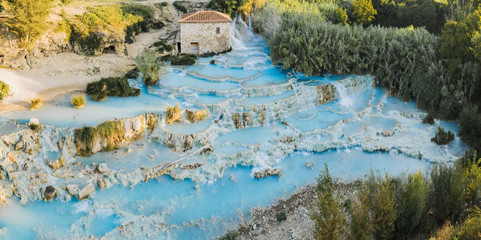 Saturnia natural spa with waterfalls and hot springs at Saturnia thermal baths, Grosseto, Tuscany, Italy. Beautiful panoramic shot.