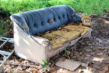Old Broken Sofa Thrown In The Trash