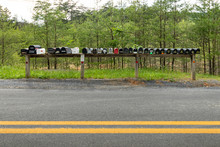 A Long Row Of Mailboxes Along ...