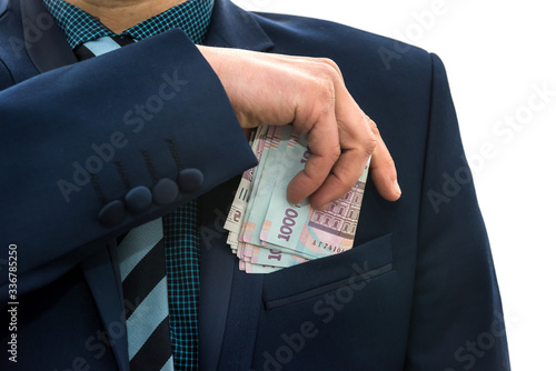 Cuadros en Lienzo businessman takes a pack of Ukrainian money as a bribe and hides in his pocket in a jacket