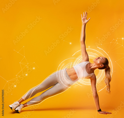Fotomural Collage with attractive sportswoman doing side plank exercise on orange background