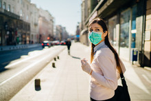 Anxious Young Adult Affected By The COVID-19.Walking,going To Work During Pandemic.Protective Measures,mask Wearing And Social Distancing.Respecting Guidelines.Avoiding Contact.Fear Of Coronavirus